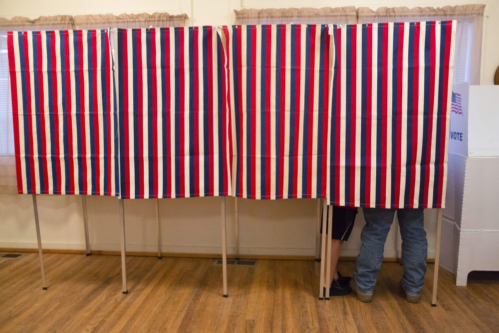 In this Nov. 8, 2016, photo, a voter fills out his ballot at the Wilson School House in unincorporated Wilson, Idaho. (Otto Kitsinger/AP)
