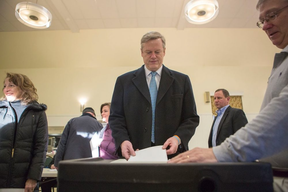 Massachusetts Governor Charlie Baker casts his vote for the Republican Presidential nomination. (Jesse Costa/WBUR)