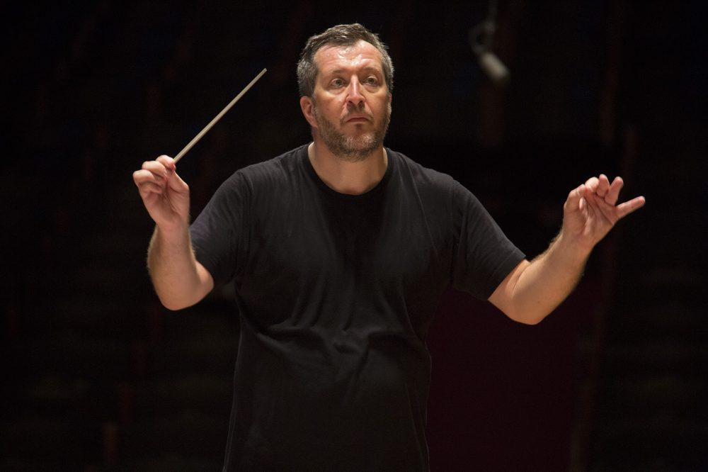 Thomas Adès, the Boston Symphony Orchestra's first artistic partner, conducts the BSO during rehearsal at Symphony Hall in November. (Jesse Costa/WBUR)