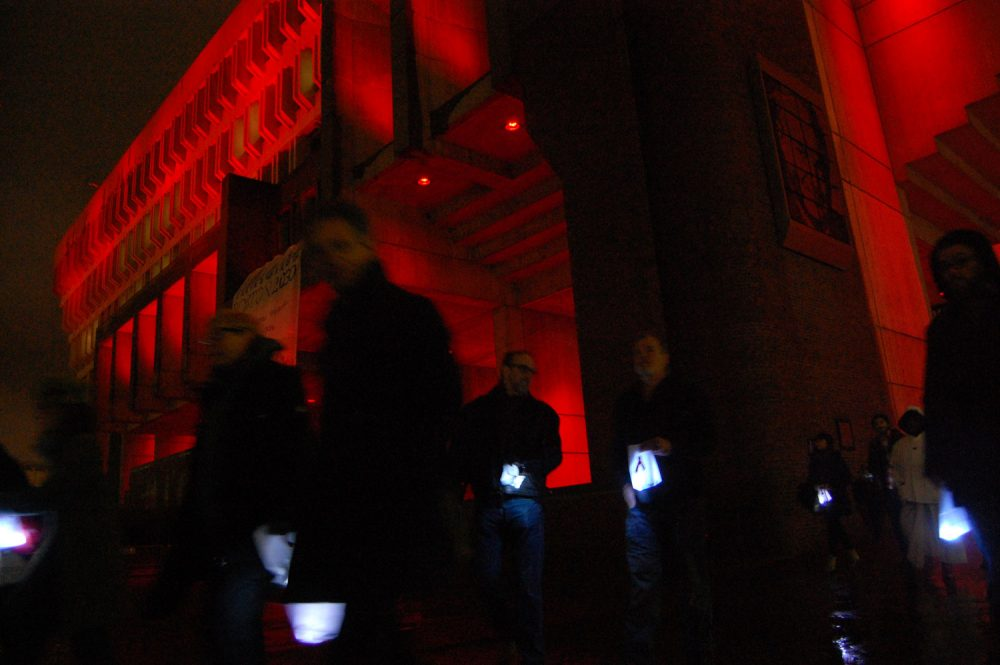 The 25th annual Medicine Wheel procession began at Boston City Hall, which was lit red for the occasion. (Greg Cook/WBUR)