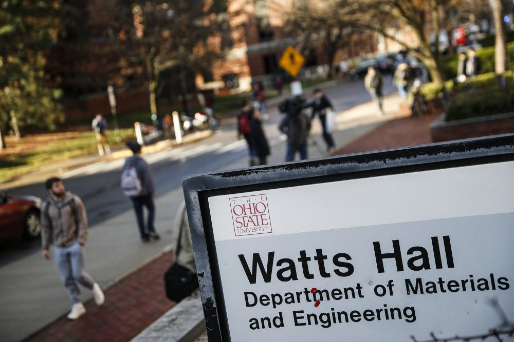 Students pass Watts Hall as they return to class following an attack at The Ohio State University campus the previous day, Tuesday, Nov. 29, 2016, in Columbus, Ohio. (John Minchillo/AP)