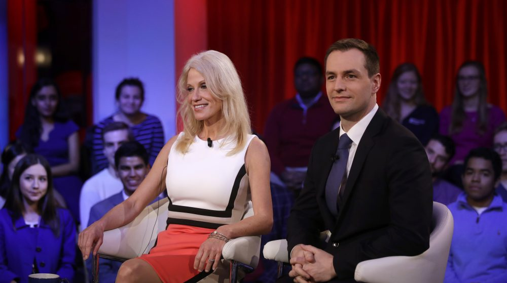Kellyanne Conway, Trump-Pence campaign manager, left, sits with Robby Mook, Clinton-Kaine campaign manager, prior to a forum at Harvard University's Kennedy School of Government in Cambridge, Mass. (Charles Krupa/AP)