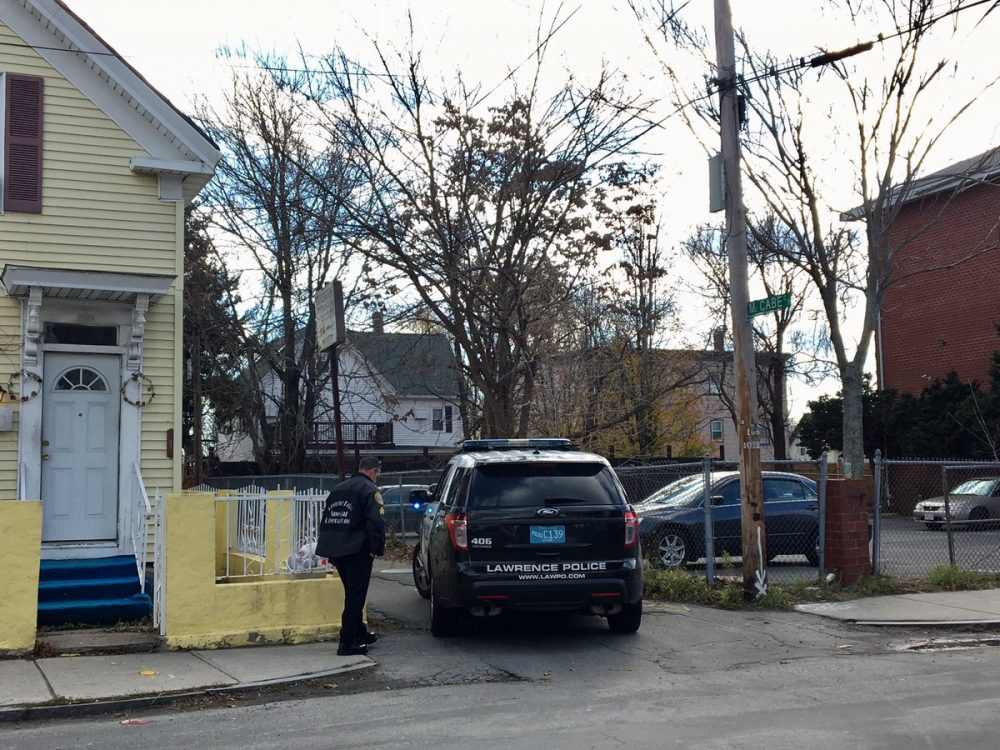 The Essex County district attorney's office confirmed Friday that the identity of the decapitated body found in Lawrence near the Merrimack River on Thursday is 16-year-old Lee Manuel Viloria-Paulino. The boy had been missing for two weeks. (Shannon Dooling/WBUR)