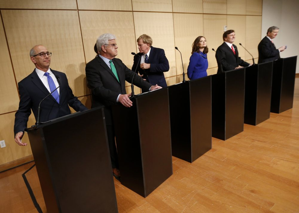 Senate candidates, left to right, Rep. Charles Boustany, D-La., Louisiana Public Service Commissioner Foster Campbell, David Duke, attorney Carolyn Fayard, Rep. John Fleming, R-La., and Louisiana Treasurer John Neely Kennedy take their places before a debate for Louisiana Senate candidates at Dillard University in New Orleans, Wednesday, Nov. 2, 2016. (Gerald Herbert/AP)