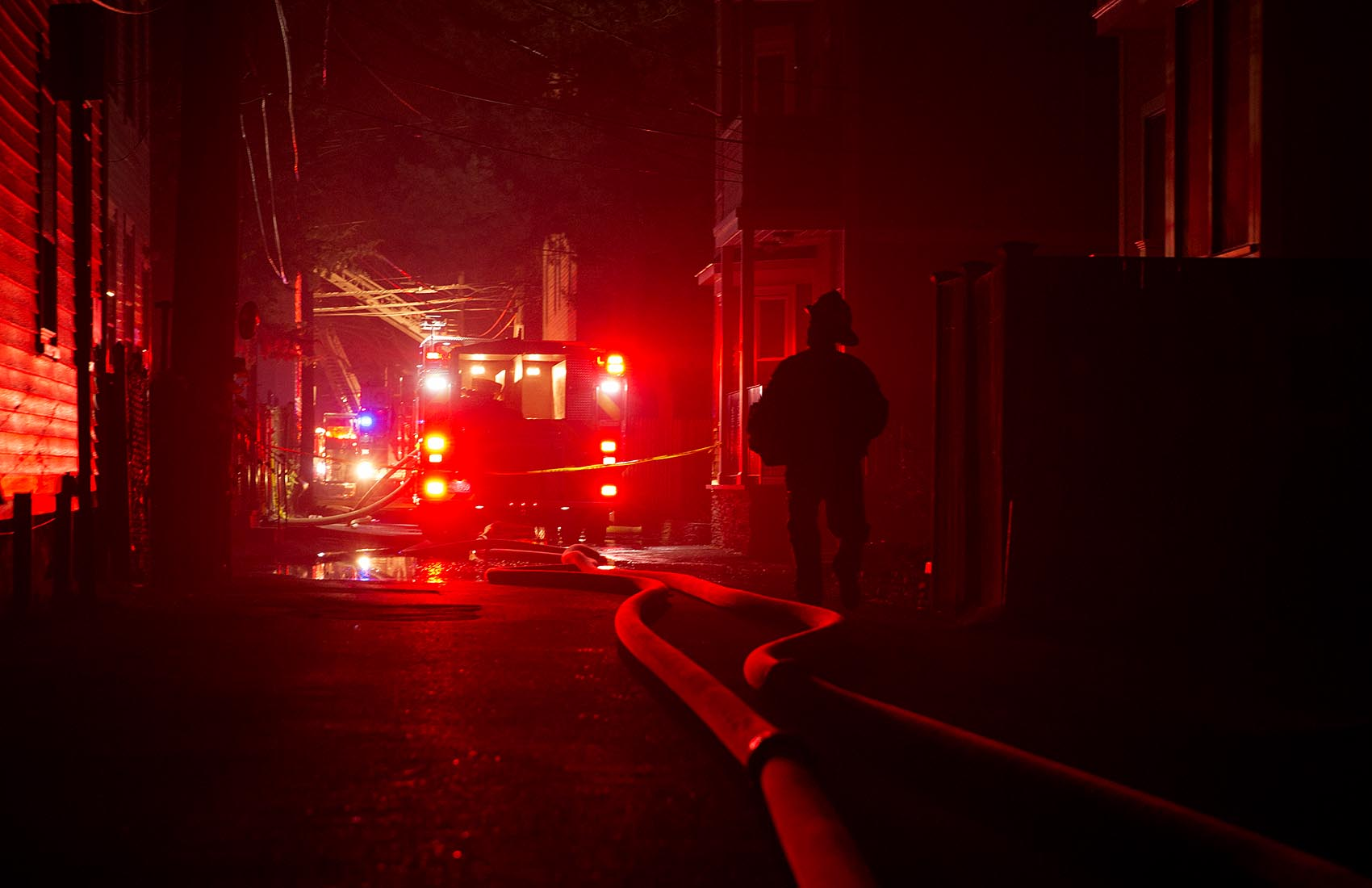 Fire trucks on York Place in Cambridge, as firefighters battle a 10-alarm fire on Saturday evening. (Robin Lubbock/WBUR)