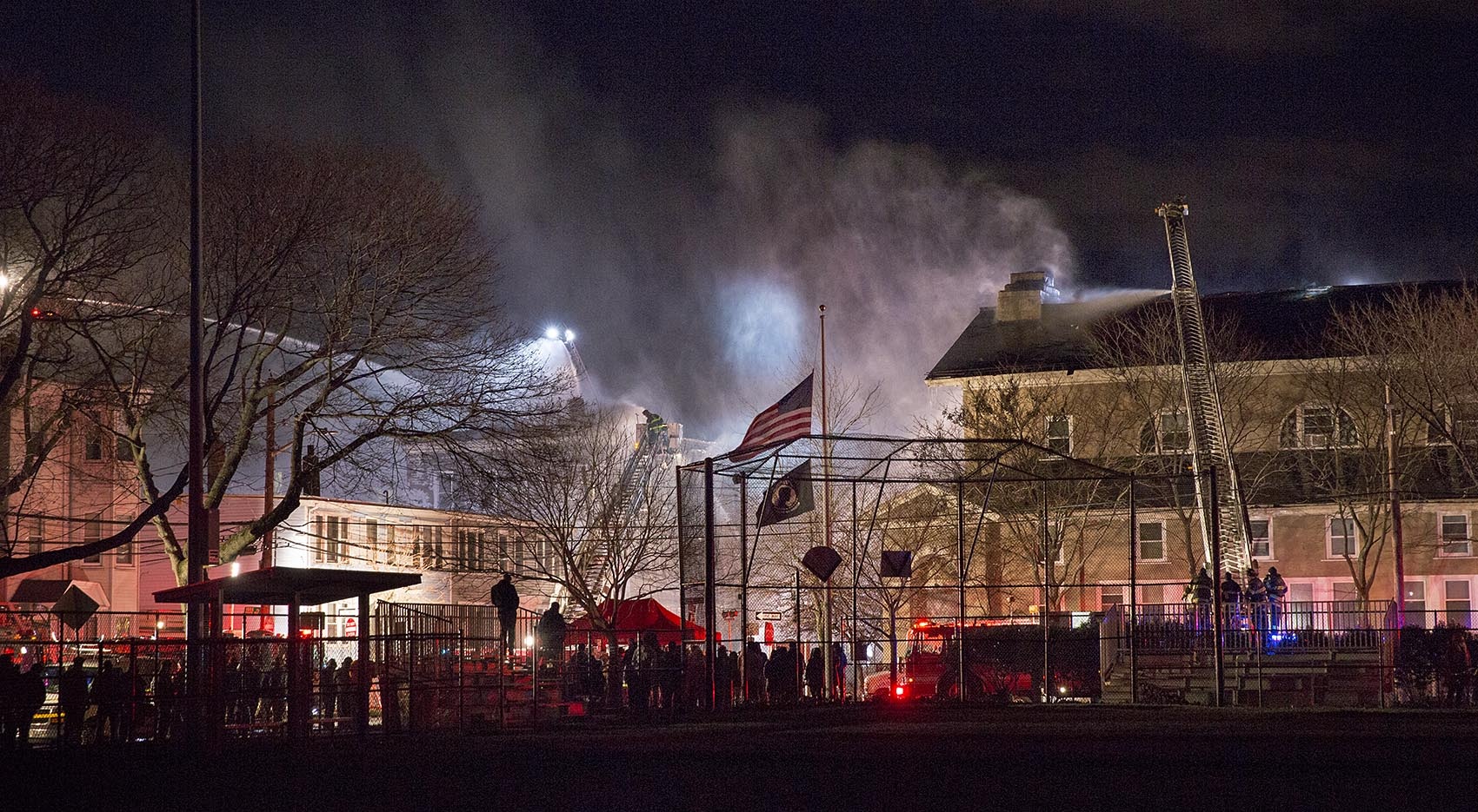 A crowd gathered as firefighters struggled to douse a blaze on Berkshire Street and York Street. (Robin Lubbock/WBUR)