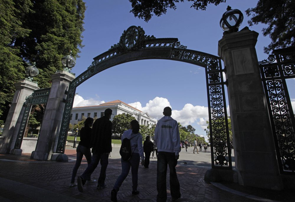 A group of students walk through the Sather Gate on the University of California, Berkeley campus in Berkeley, Calif., in August 2011. (Eric Risberg/AP)