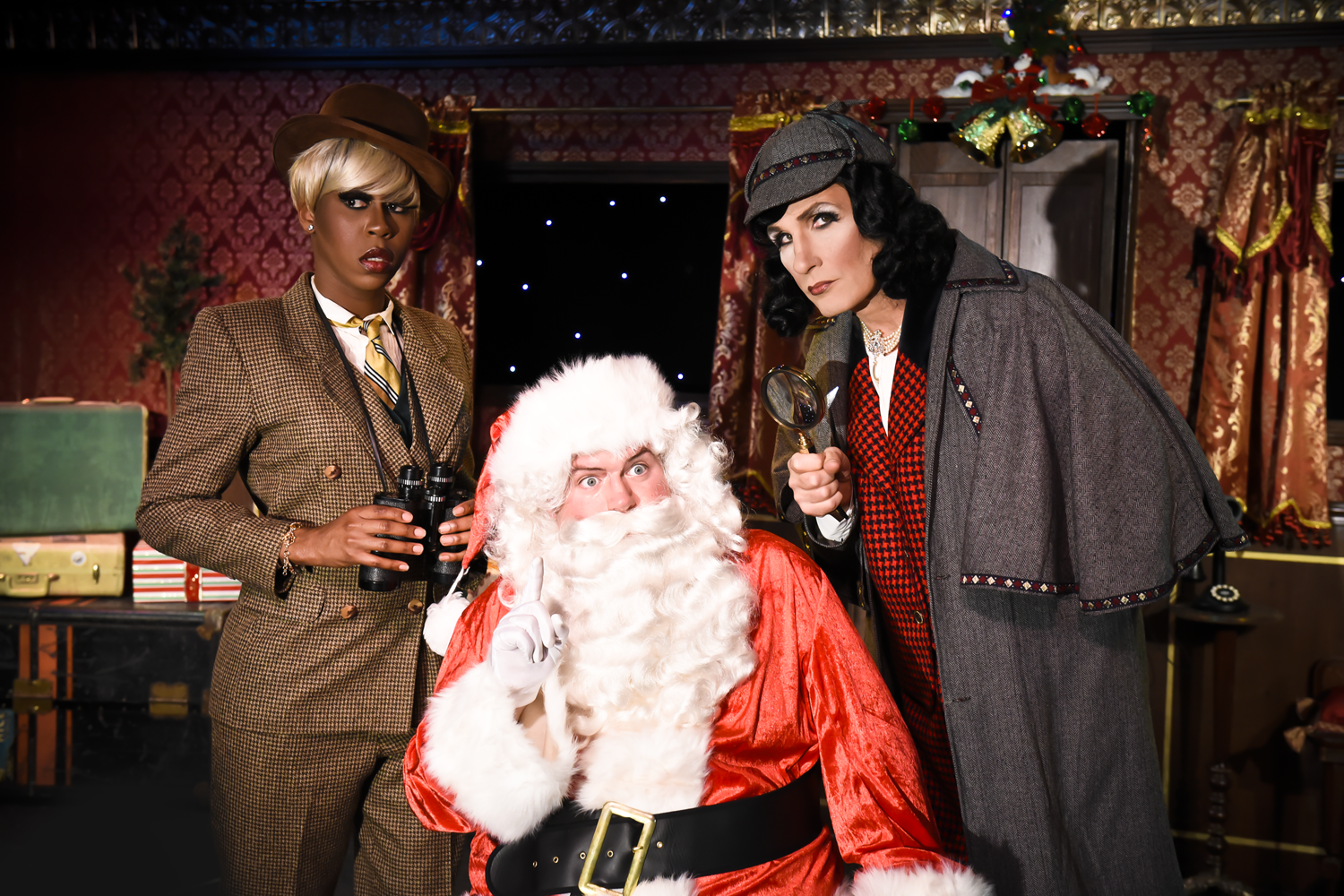 """Ryan Landry, right, poses with Santa and another detective in his production of """"Murder on the Polar Express."""" (Courtesy Miss Corey Banda)"""