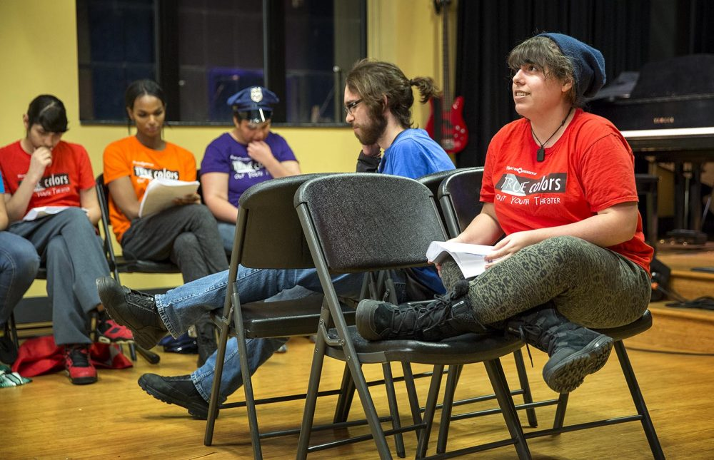 Jasper Torres Charpentier, wearing a red T-shirt, performs with the youth theater troupe. (Robin Lubbock/WBUR)