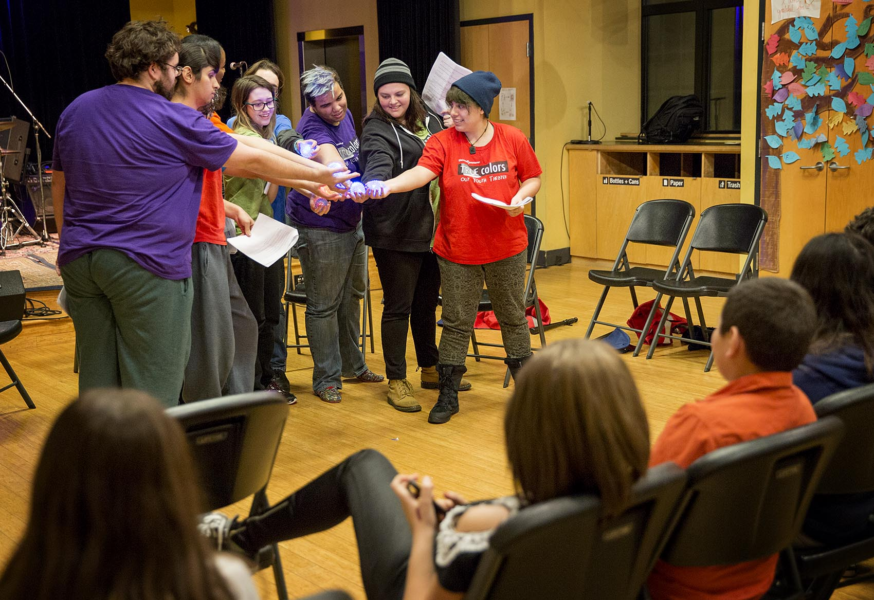 Members of the Boston-based theater troupe True Colors conclude a reading at Zumix in East Boston. (Robin Lubbock/WBUR)