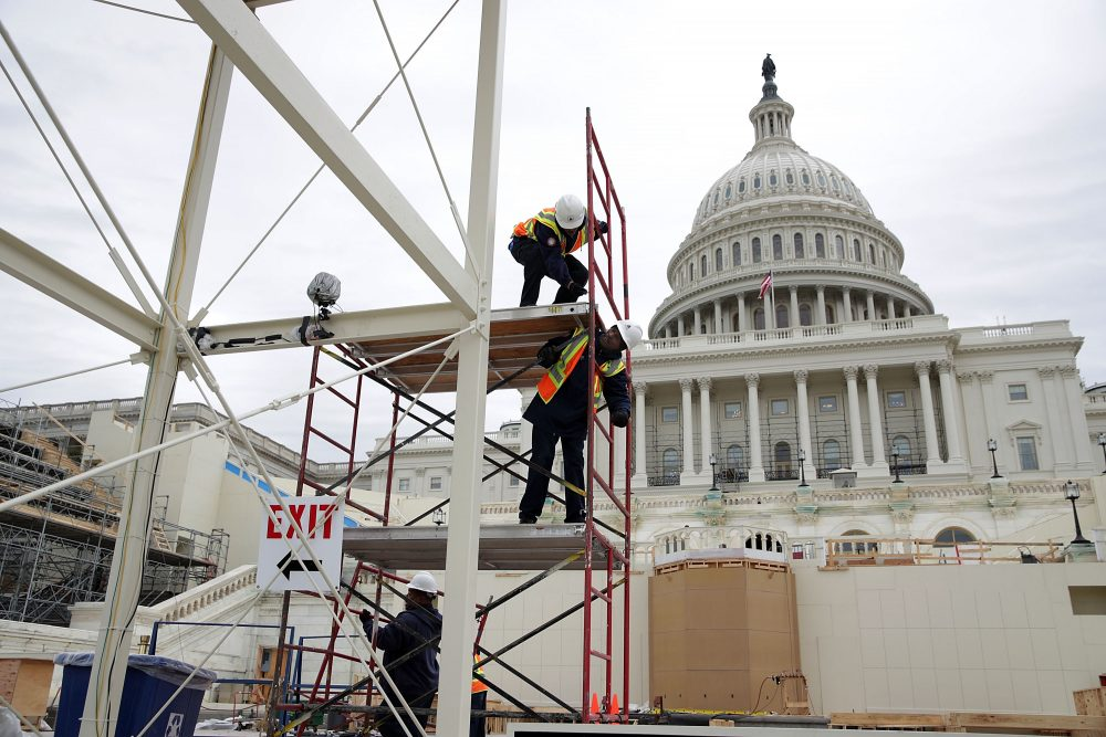 Employees of the Architect of the Capitol build a scaffolding at the West Front of the Capitol as construction of the 2017 presidential inaugural platform continues Dec. 8, 2016 on Capitol Hill in Washington, D.C. (Alex Wong/Getty Images)