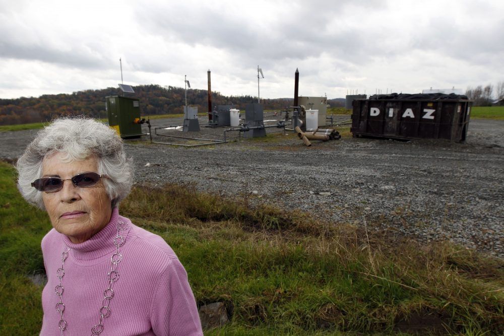 Jean Carter poses for a photograph on her property with a gas well next door Friday, Oct. 14, 2011 in Dimock, Pa. State regulators blame faulty gas wells drilled by Cabot Oil & Gas Corp for leaking methane into the groundwater in Dimock, Pa. (Alex Brandon/AP)