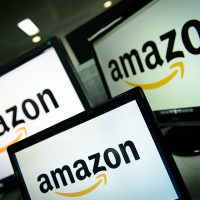 A picture shows the logo of the online retailer Amazon dispalyed on computer screens in London on Dec. 11, 2014. (Leon Neal/AFP/Getty Images)