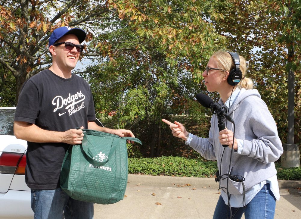 James Silva, 30, of Postmates, delivers hot chicken to WPLN's Meribah Knight. (Tony Gonzalez/WPLN)