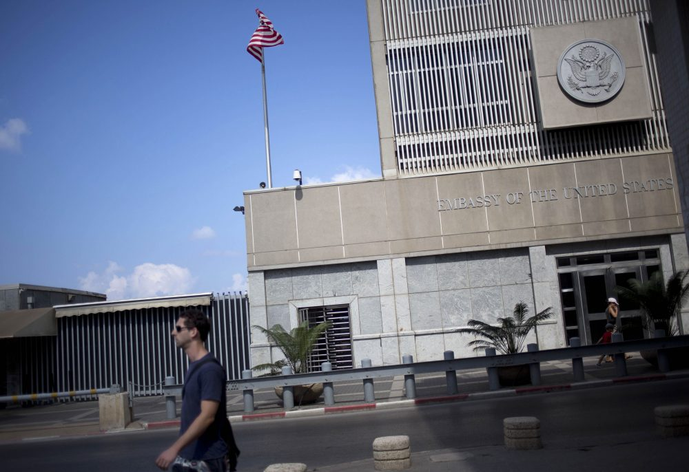 A man walks past the U.S. Embassy in Tel Aviv, Israel, in 2013. (Ariel Schalit/AP)
