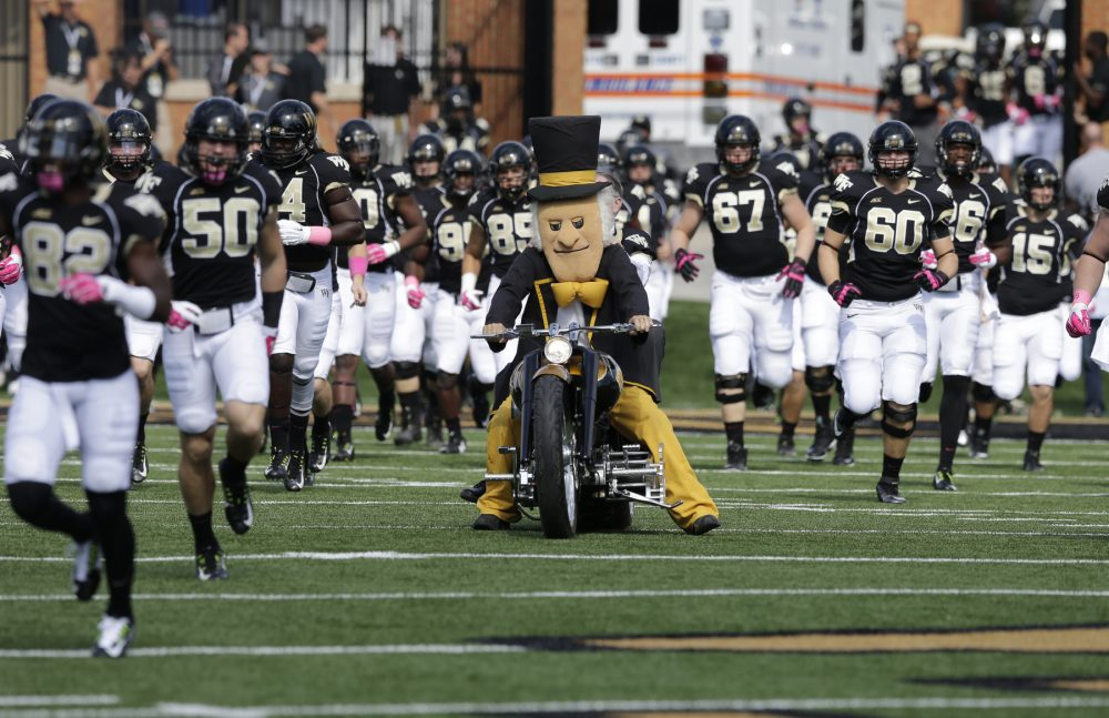 Wake Forest players take the field before a game against Syracuse in Winston-Salem, N.C., Saturday, Oct. 18, 2014. (Chuck Burton/AP)
