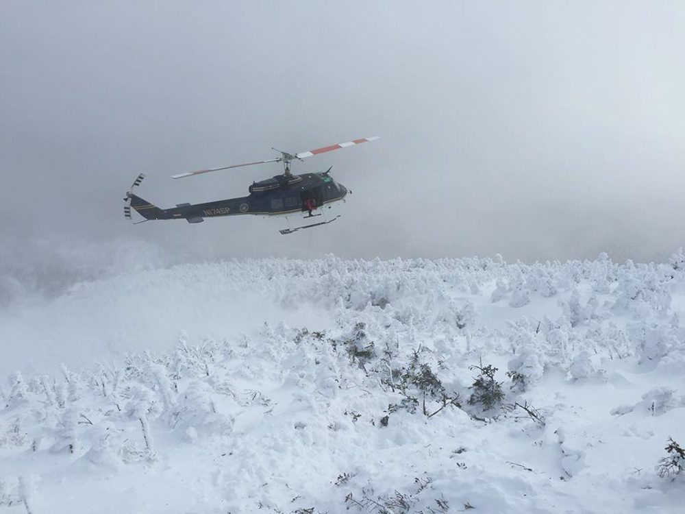 New York State Police helicopter prepares to hoist up one of the lost hikers. (Courtesy NYS DEC Forest Rangers)