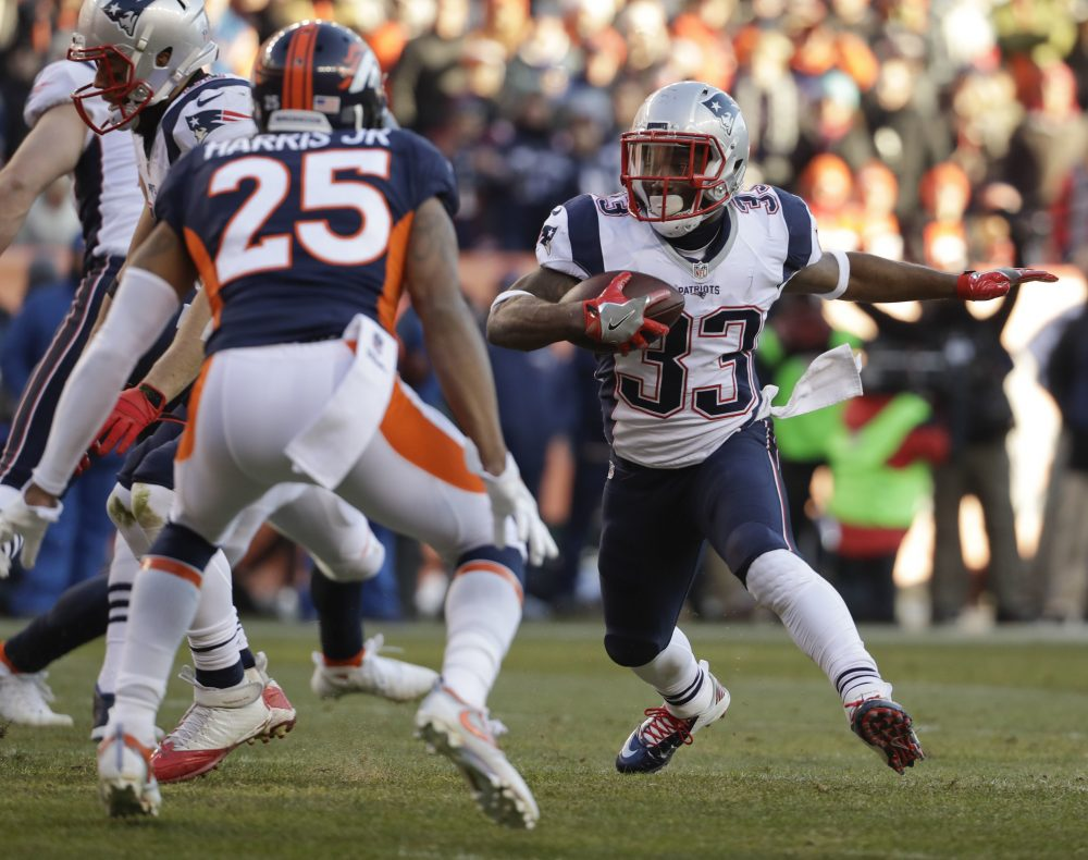 New England Patriots running back Dion Lewis runs against the Denver Broncos during the first half of an NFL football game on Sunday in Denver. (Jack Dempsey/AP)