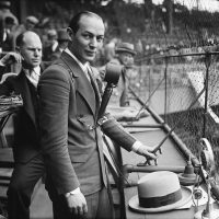Legendary sports broadcaster Ted Husing helped his cousin's family escape Nazi Germany. But he never talked about it publicly. (Harris Ewing Collection/Wikimedia)