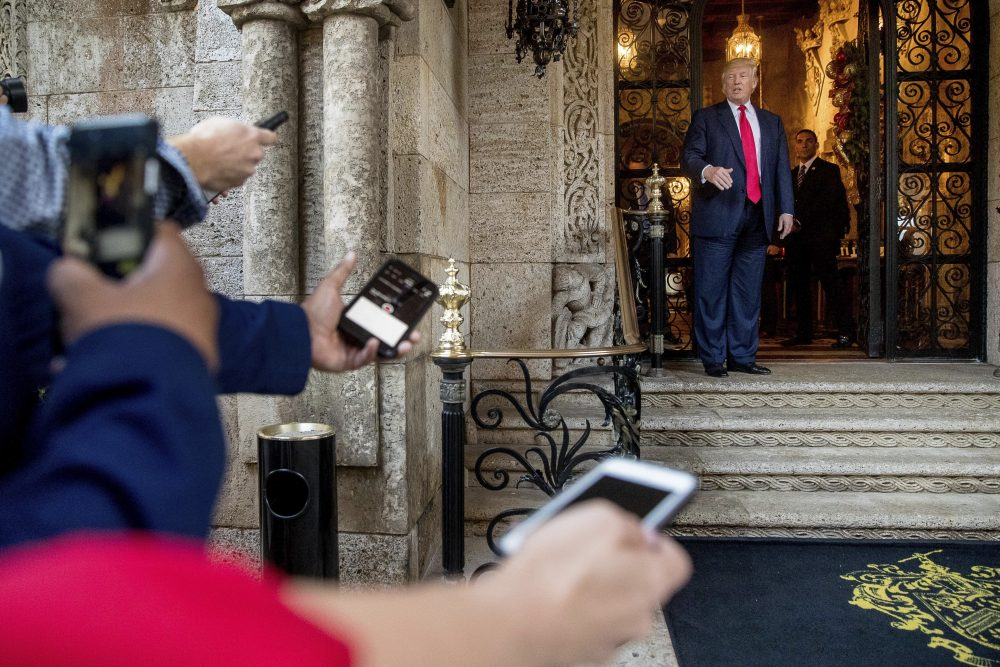 President-elect Donald Trump, right, speaks to members of the media after a meeting with admirals and generals from the Pentagon at Mar-a-Lago, in Palm Beach, Fla., Wednesday, Dec. 21, 2016. (Andrew Harnik/AP)