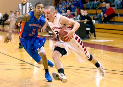 Jack Taylor drives to the hoop in a 2013 game against Crossroads College. (Justin Hayworth/AP)