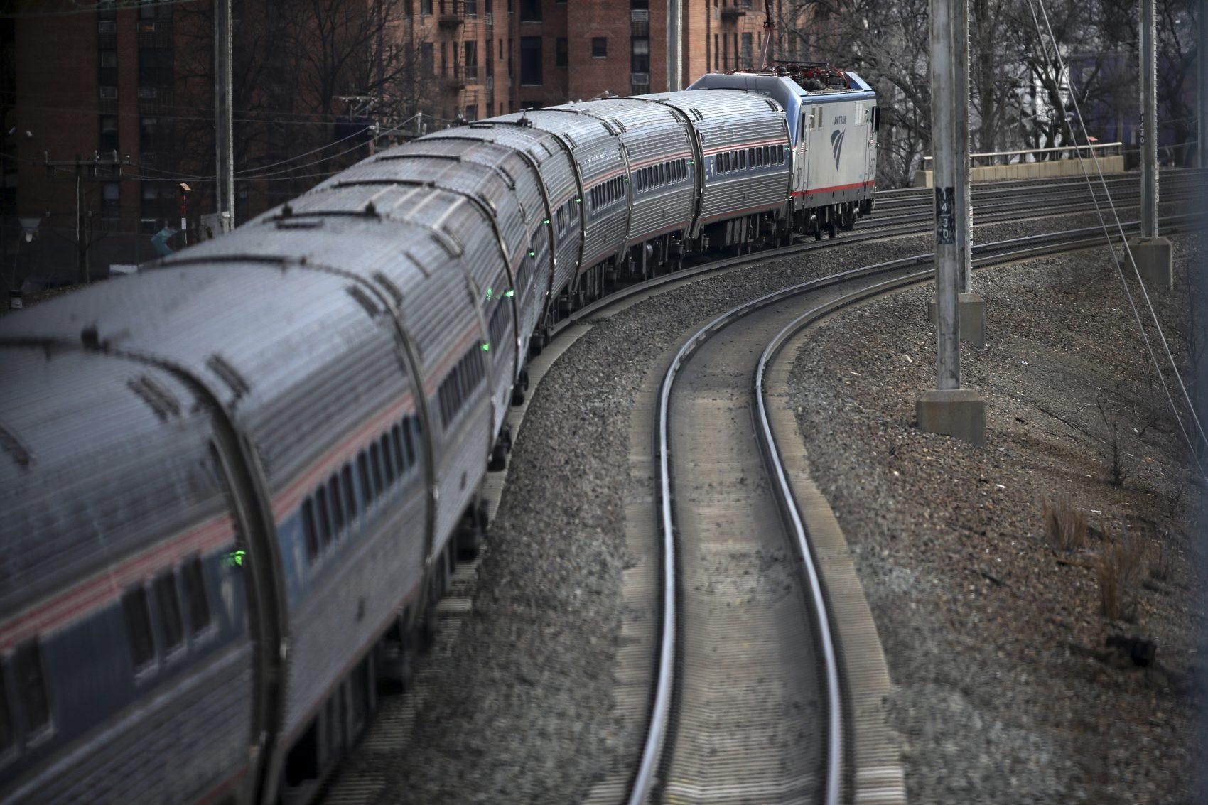 An Amtrak train passes through Elizabeth train station in March 2016, in Elizabeth, N.J., along Amtrak's Northeast Corridor. (Mel Evans/AP)
