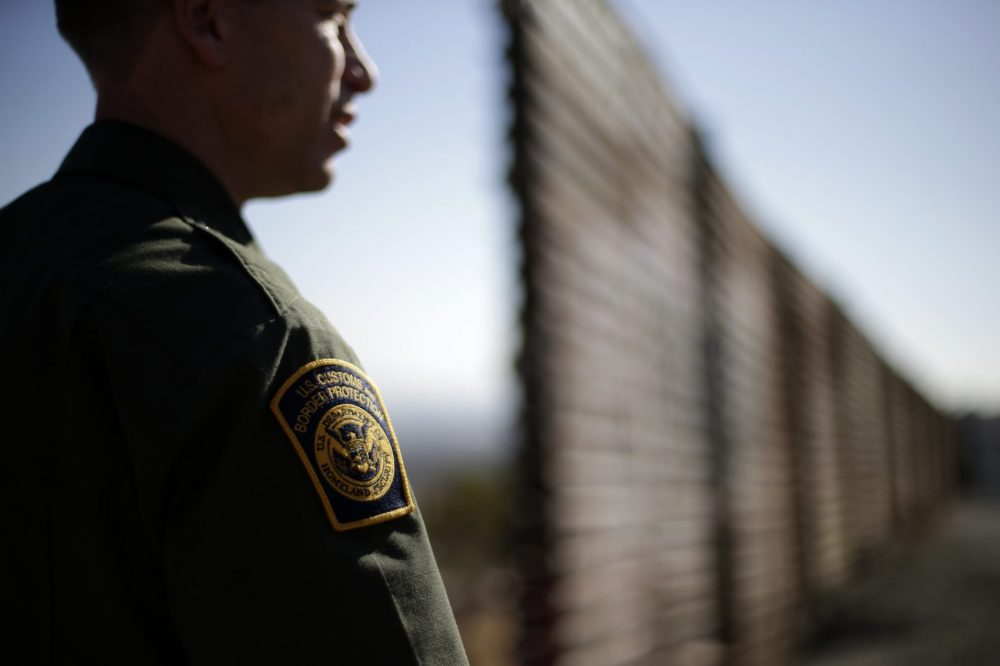 In this June 13, 2013 picture, U.S. Border Patrol agent Jerry Conlin looks to the north near where the border wall ends as is separates Tijuana, Mexico, left, and San Diego, right. (Gregory Bull/AP)