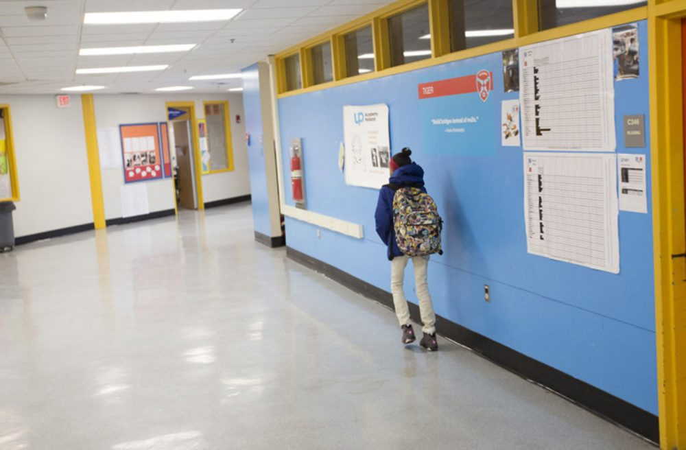 A student heads to class at UP Academy Holland. (Joe Difazio for WBUR)