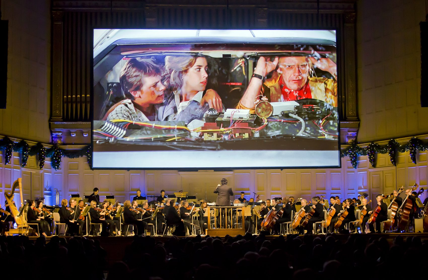 "Boston Pops musicians play a ""live-to-picture"" ""Back to the Future"" show at Symphony Hall in Boston, Friday, Dec. 30, 2016. (Winslow Townson)"