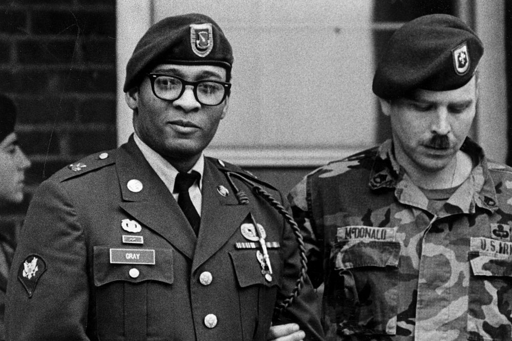 Spec. Ronald A. Gray, pictured leaving a Fort Bragg courtroom escorted by military police in April 1988. (Marcus Castro/The Fayetteville Observer/AP)