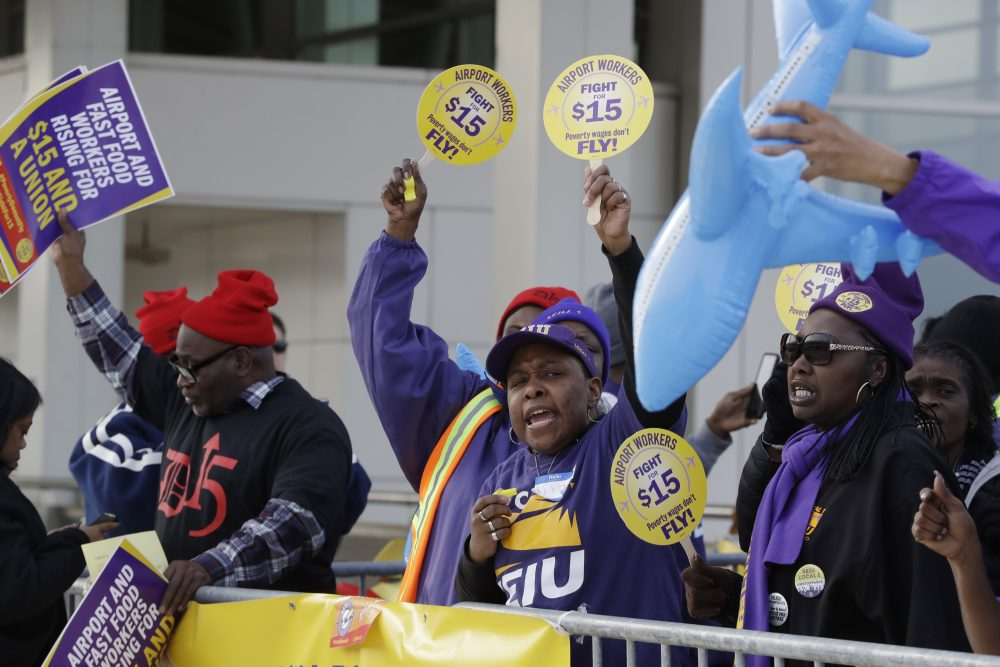 SEIU Local 1 union members protest for an increase in the minimum wage, Tuesday, Nov. 29, 2016, at the Detroit Metropolitan Airport in Romulus, Mich. (Carlos Osorio/AP)