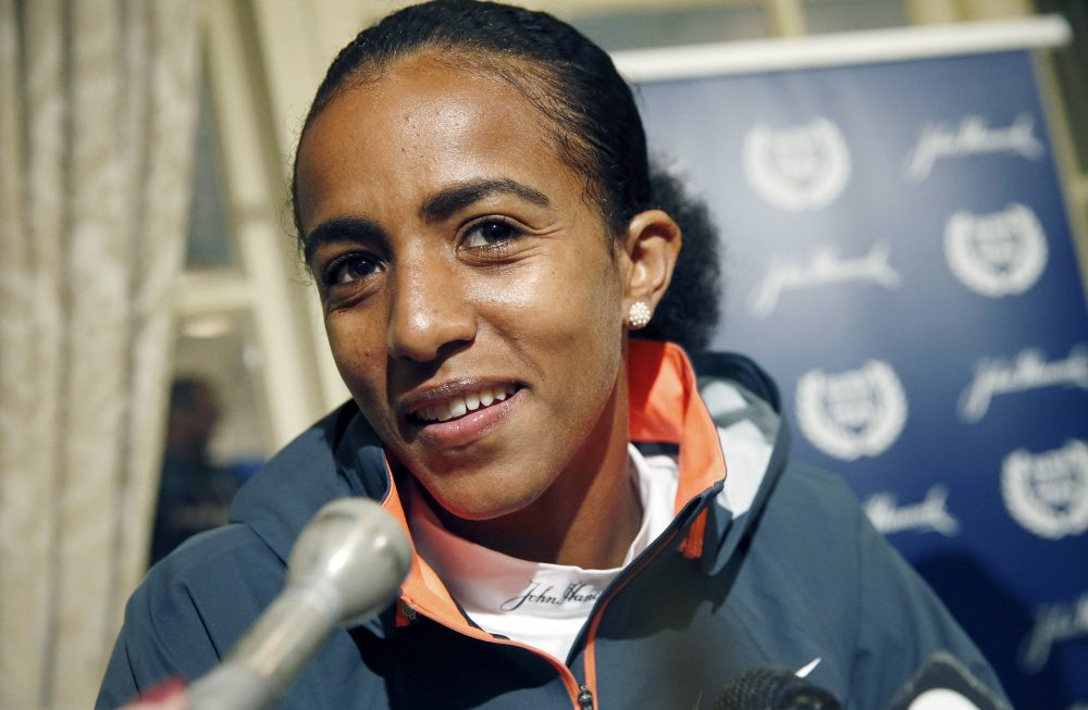The BAA on Monday officially awarded the 2014 Boston Marathon victory to Buzunesh Deba of Ethiopia, pictured here during a press conference before the 2015 marathon. Deba finished second in 2014 but will get the title after Rita Jeptoo was stripped of her win after testing positive for a banned substance. (Michael Dwyer/AP)