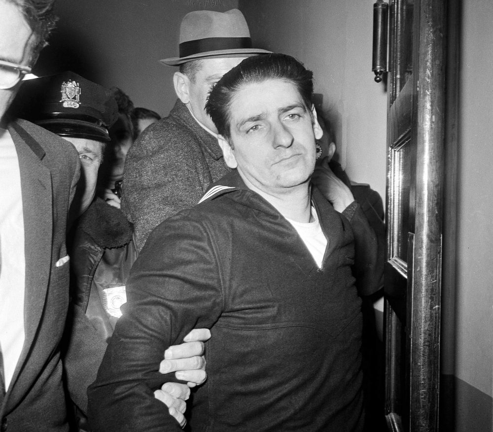 In this Feb. 25, 1967 black and white file photo, self-confessed Boston Strangler Albert DeSalvo is taken into custody after his capture north of Boston in Lynn, Mass. (Frank C. Curtin/AP)