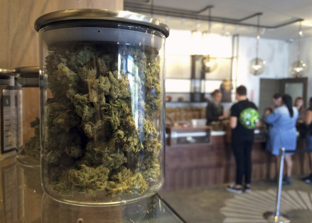 In this April 20, 2016 file photo, customers buy products at the Harvest Medical Marijuana Dispensary in San Francisco, Calif.  (Haven Daley/AP/File)