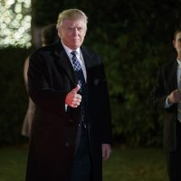 President-elect Donald Trump gestures toward reporters as he arrives for a party at the home of Robert Mercer, one of his biggest campaign donors, Saturday, Dec. 3, 2016, in Head of the Harbor, N.Y. (Evan Vucci/AP)