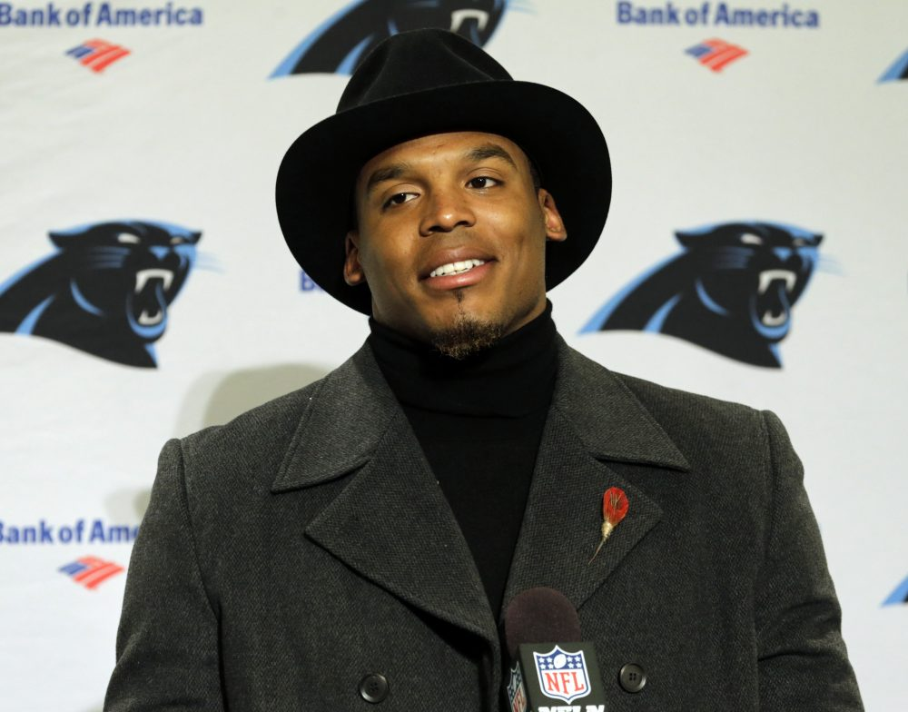 On Sunday night, Panthers QB Cam Newton was benched for his team's first series because he didn't wear a necktie to the stadium. (Stephen Brashear/AP)