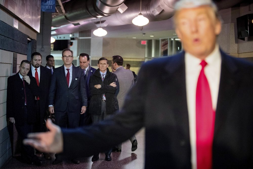President-elect Donald Trump's Chief of Staff Reince Priebus, left; Jason Miller, a senior adviser, second from left; Boris Epshteyn, a spokesman for Trump, fourth from left, and Michael Flynn, Trump's nominee for National Security adviser, fifth from left, listen as Trump speaks to members of the media on Thursday, Dec. 8, 2016. (Andrew Harnik/AP)