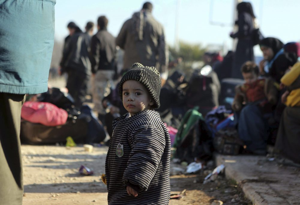 A young Syrian child evacuated from the embattled Syrian city of Aleppo during the ceasefire arrives at a refugee camp in Rashidin, near Idlib, Syria, early Monday, Dec. 19, 2016. The Security Council on Monday approved the deployment of U.N. monitors to the Syrian city of Aleppo as the evacuation of fighters and civilians from the last remaining opposition stronghold resumed after days of delays. (AP)
