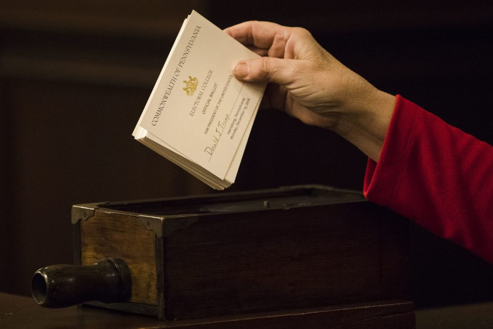 A teller places ballots into a box after tallying elector's votes during Pennsylvania's 58th Electoral College at the state Capitol in Harrisburg, Pa., Monday, Dec. 19, 2016. (Matt Rourke/AP)