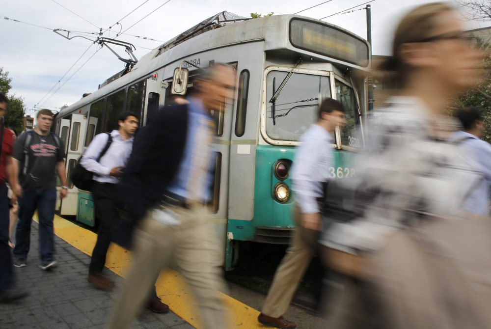 In this Wednesday, June 17, 2015 photo, commuters disembark from a Massachusetts Bay Transportation Authority train in Brookline, Mass. The subway system in the Boston metro area is the nation's oldest, launched in 1897. Public transportation has long been hailed as a certain remedy for traffic congestion, but many of the nation's largest mass transit systems are struggling to keep up with maintenance and expansion. (AP Photo/Steven Senne)