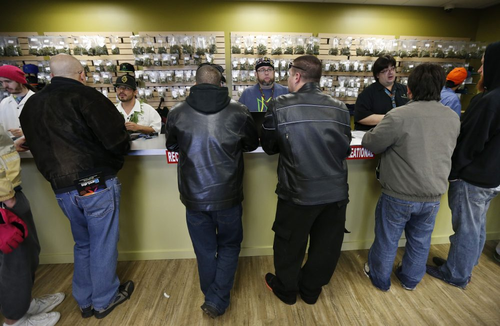 The scene inside a Denver Medicine Man marijuana retail store on Jan. 1, 2014 -- the first day of retail sales. (Brennan Linsley/AP)