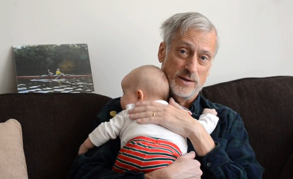 David Kimball holds one of his grandchildren. (Courtesy of the author)