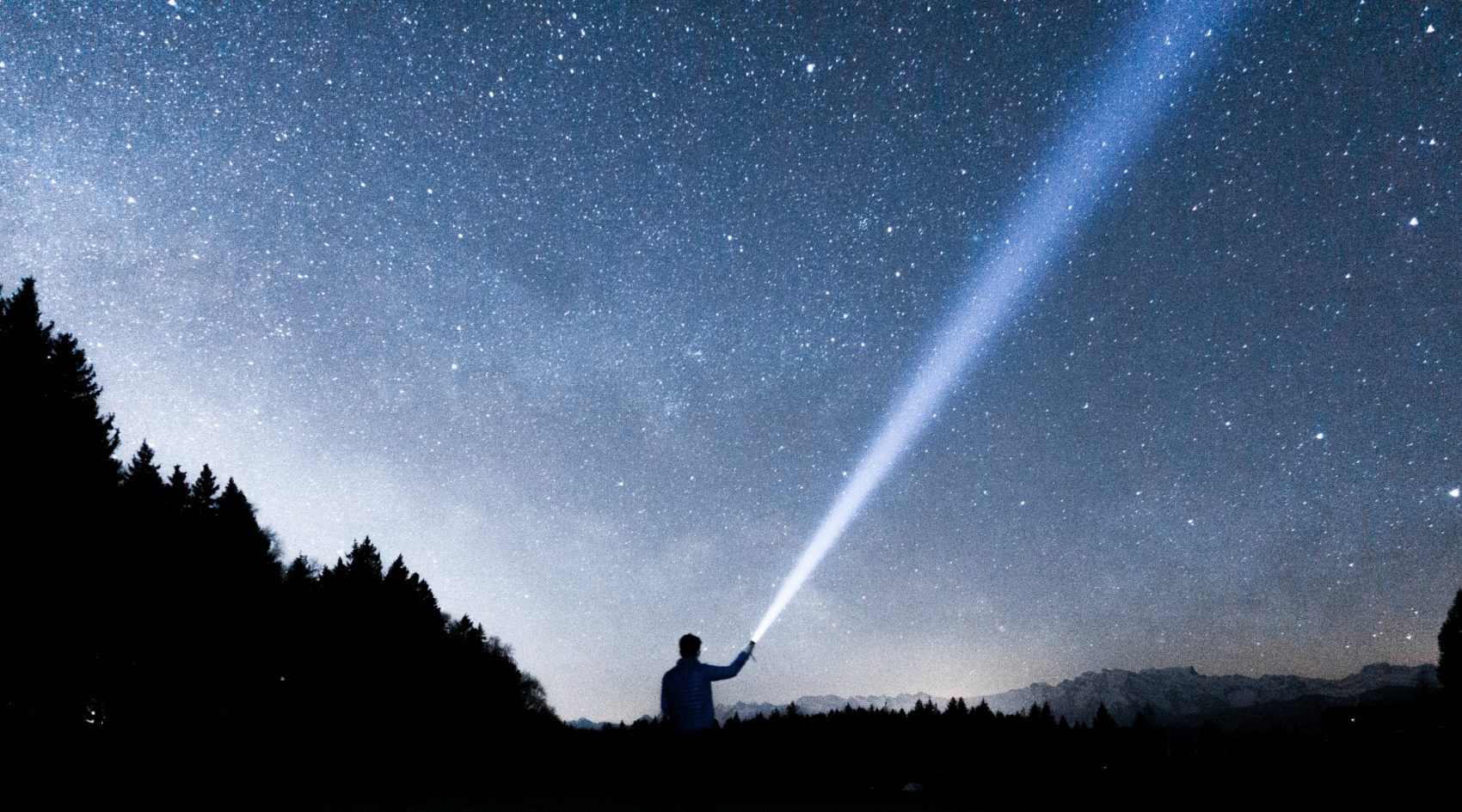 He doesn't really put the stars in the night sky, but, Bill Eville writes, while his children are far from home, he is still trying so hard to be their guiding light. (Martin Sattler/Unsplash)