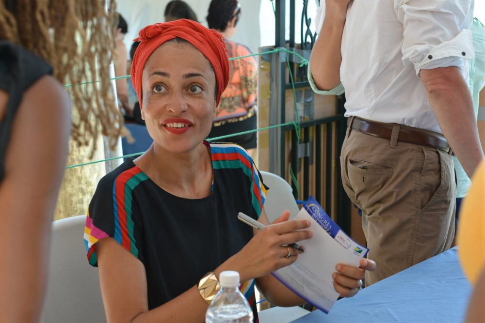 It's important, writes Layla Schlack, for those of us who claim to be progressive, anti-racist, feminist, pro-equal rights, to understand what it's like not being part of the dominant culture. Pictured: Novelist Zadie Smith is shown signing a book for a fan. (David McFadden/AP)
