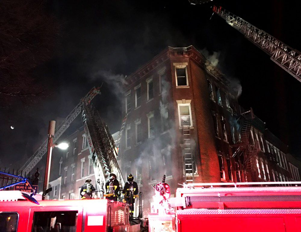 Firefighters battle a five-alarm fire on Christmas morning in the North End. (Boston Fire Department/Twitter)
