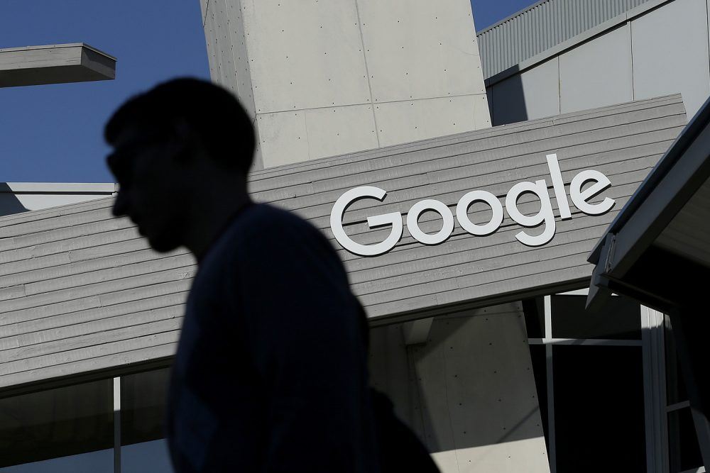 In this file photo, a man walks past a building on the Google campus in Mountain View, Calif. (Jeff Chiu/AP)