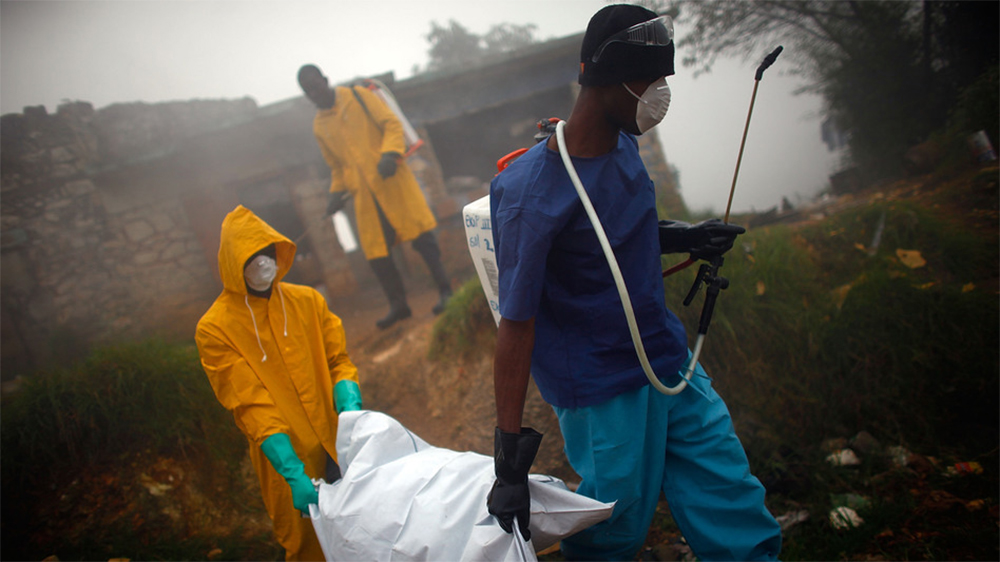 Health workers collect the body of a cholera victim in Petionville, Haiti, in February 2011. The disease first appeared on the island in October 2010. (NPR)