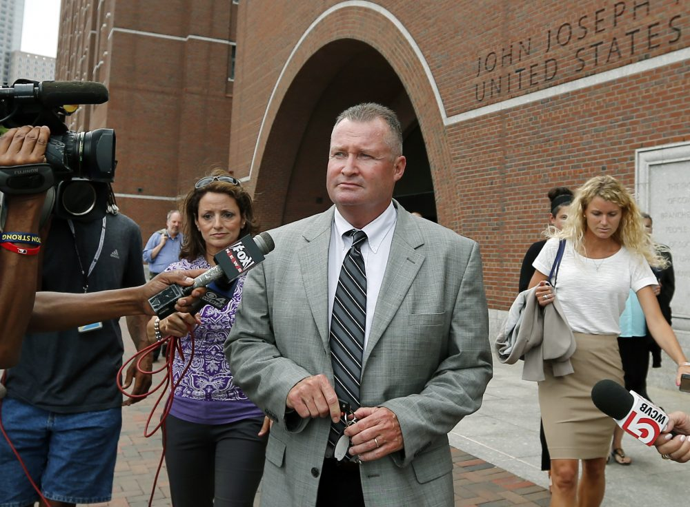 Former Massachusetts state probation commissioner John O'Brien leaves federal court in Boston in 2014 where closing arguments were completed in his trial. (Elise Amendola/AP)