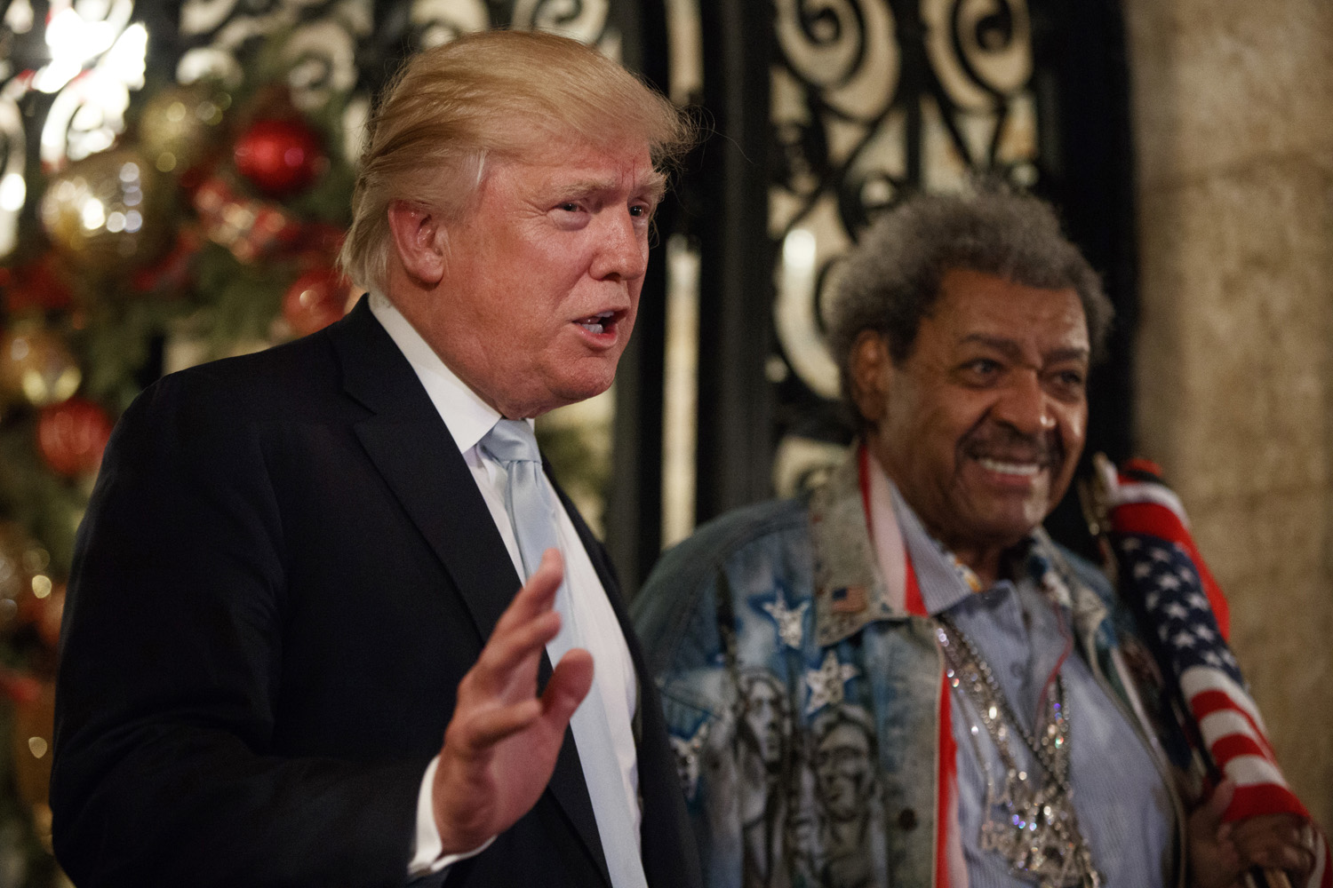 President-elect Donald Trump, left, stands with boxing promoter Don King as he speaks to reporters at Mar-a-Lago, Wednesday, Dec. 28, 2016, in Palm Beach, Fla. (Evan Vucci/AP)