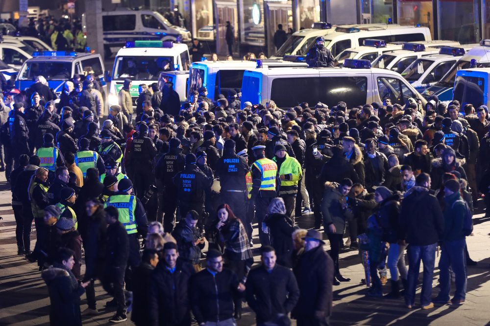 Police in Cologne, Germany hold a group of men in front of Hauptbahnhof main railway station. (Maja Hitij/Getty Images)